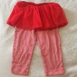 Red striped leggings with attached tulle skirt.